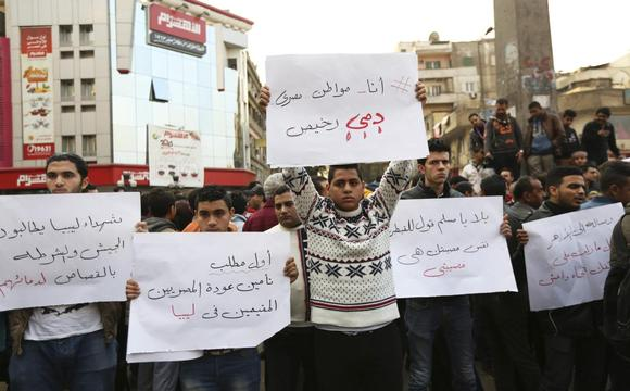 Egyptian Christians hold placards during a protest against the killing of Egyptian Coptic Christians by militants of the Islamic State in Libya, in Cairo February 16, 2015.   REUTERS/Mohamed Abd El Ghany