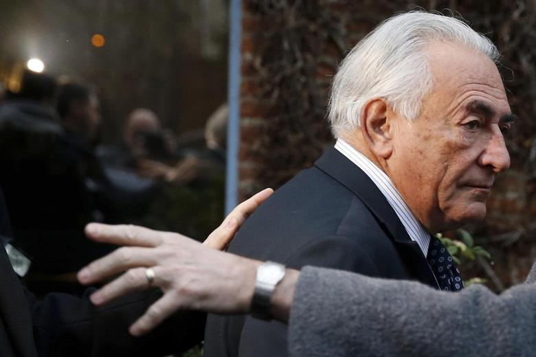 Former IMF head Dominique Strauss-Kahn leaves his hotel to attend the trial in the so-called Carlton Affair, in Lille, February 17, 2015, where 14 people including Strauss-Kahn stand accused of sex offences including the alleged procuring of prostitutes. Strauss-Kahn is charged with ''procuring with aggravating circumstances''. REUTERS/Pascal Rossignol