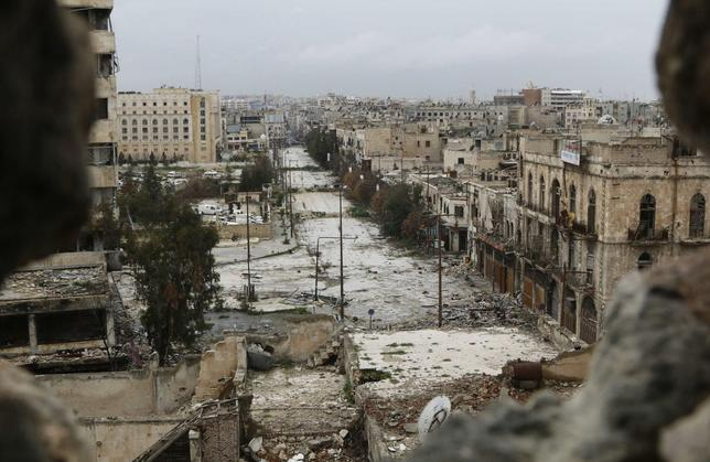 A general view shows damaged buildings along a deserted street and an area controlled by forces loyal to Syria's President Bashar Al-Assad, as seen from a rebel-controlled area at the Bab al-Nasr frontline in Aleppo February 10, 2015. REUTERS/Hosam Katan