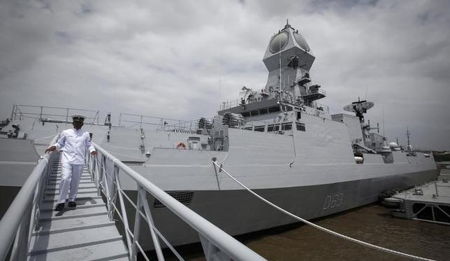 An Indian navy serviceman walks down the gangplank of the newly commissioned warship, INS Kolkata, during its commissioning ceremony at a naval base in Mumbai August 16, 2014. REUTERS/Danish Siddiqui/Files