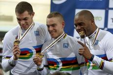 France's Kevin Sireau, Michael D'Almeida and Gregory Bauge (L-R) show off their gold medals after winning the men's team sprint event at the UCI Track Cycling World Cup in Saint-Quentin-en-Yvelines, near Paris, February 18, 2015. REUTERS/Charles Platiau
