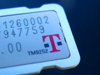 The SIM card for a T-Mobile phone is illustrated in this  photograph in  Encinitas, California October, 27, 2014.  REUTERS/Mike Blake