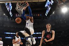 February 15, 2015; New York, NY, USA; Eastern Conference forward Carmelo Anthony of the New York Knicks (7) dunks against Western Conference forward Dirk Nowitzki of the Dallas Mavericks (41) during the second half of the 2015 NBA All-Star Game at Madison Square Garden. The West defeated the East 163-158. Mandatory Credit: Bob Donnan-USA TODAY Sports