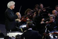 Conductor Simon Rattle takes part in the opening ceremony of the London 2012 Olympic Games at the Olympic Stadium July 27, 2012. REUTERS/Mike Blake
