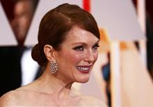 "Julianne Moore, best actress nominee for her role in ""Still Alice,"" arrives  at the 87th Academy Awards in Hollywood, California February 22, 2015.   REUTERS/Lucas Jackson"