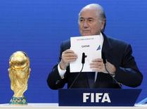 FIFA President Sepp Blatter announces Qatar as the host nation for the FIFA World Cup 2022, in Zurich in this December 2, 2010 file photo.  REUTERS/Christian Hartmann/Files