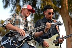 PGA golfer Russell Henley (left) performs with O.A.R. guitarist Richard On after the third round of the Northern Trust Open at Riviera Country Club. Mandatory Credit: Jake Roth-USA TODAY Sports