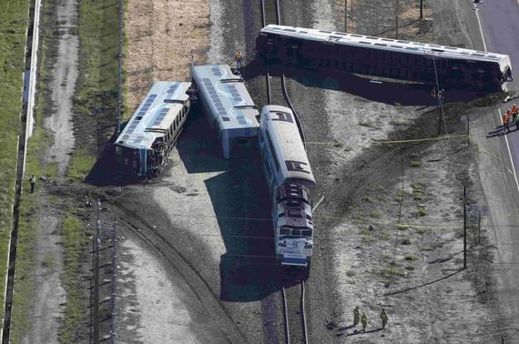 An aerial view shows the scene of a double-decker Metrolink train derailment in Oxnard, California February 24, 2015.   REUTERS-Lucy Nicholson
