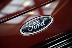 A Ford logo is seen during preparations for the 2014 LA Auto Show in Los Angeles, California November 18, 2014. REUTERS/Lucy Nicholson