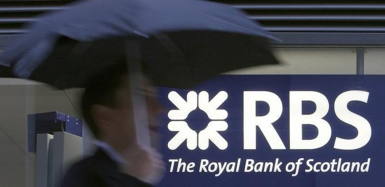 A pedestrian walks past a Royal Bank of Scotland branch, in central London October 7, 2008. REUTERS/Alessia Pierdomenico