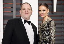 Producer Harvey Weinstein and wife, designer Georgina Chapman, arrive at the 2015 Vanity Fair Oscar Party in Beverly Hills, California February 22, 2015. REUTERS/Danny Moloshok