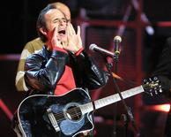 French singer Jean-Jacques Goldman jokes about an electrical failure during his performance at the NRJ music awards in Cannes January 19, 2002. - RTXL0IL