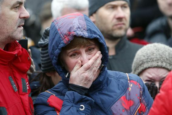 People react at the site, where Boris Nemtsov was recently murdered, in central Moscow, February 28, 2015.   REUTERS-Sergei Karpukhin