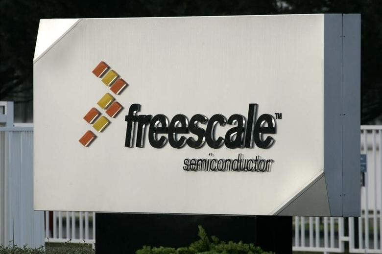 The logo of Freescale Semiconductor Inc is seen at the entrance of the plant in Toulouse, southwestern France, April 24, 2009. REUTERS/Jean-Philippe Arles