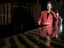Michael Van Cleef Ault, owner of Pangaea Singapore, poses during an interview with Reuters in his club underneath the casino complex of the Marina Bay Sands December 4, 2014.  REUTERS/Edgar Su