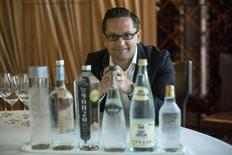 German water sommelier Martin Riese poses for a portrait by bottles of water to be used in a water tasting class at Patina restaurant in Los Angeles, California February 25, 2015. REUTERS/Mario Anzuoni