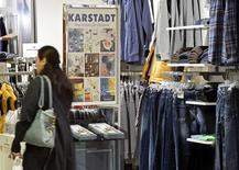 A shopper walks through a Karstadt department store in Hamburg-Billstedt October 24, 2014.   REUTERS/Fabian Bimmer