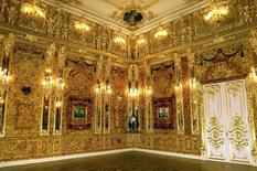 File photo of Russia's legendary Amber Room, back in place in the Catherine Palace outside St Petersburg after 20 years of painstaking reconstruction by  Russian craftsmen, May 13, 2003.     REUTERS/Alexander Demianchuk