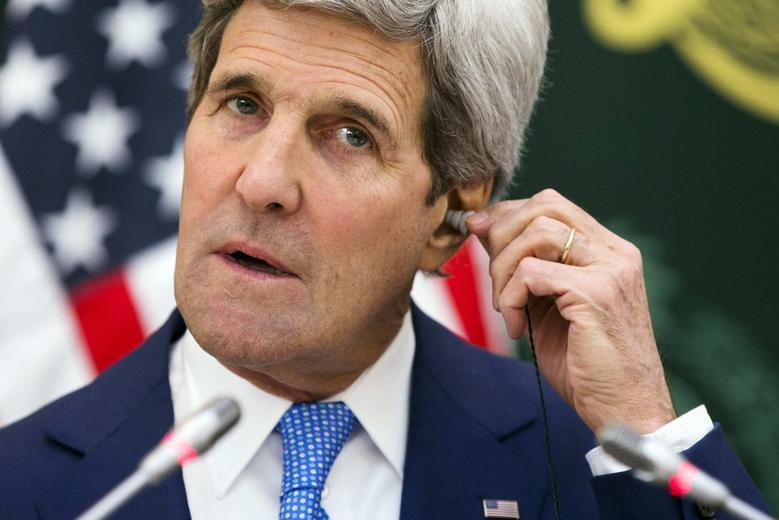 U.S. Secretary of State John Kerry puts in an earpiece for translation during a news conference with Saudi Arabia's Foreign Minister Saud bin Faisal bin Abdulaziz Al Saud in Riyadh March 5, 2015.  REUTERS/Evan Vucci/Pool