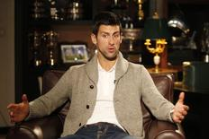 Tennis player Novak Djokovic of Serbia talks during an interview in Belgrade March 1, 2015. REUTERS/Djordje Kojadinovic
