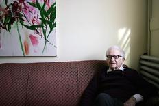 Albert Maysles poses for a picture at his offices in New York in this file photo taken on March 6, 2006. REUTERS/Seth Wenig