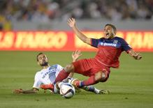 Mar 6, 2015; Carson, CA, USA; Chicago Fire forward Quincy Amarikwa (24) is defended by Los Angeles Galaxy midfielder Juninho (19) at StubHub Center. Mandatory Credit: Kirby Lee-USA TODAY Sports