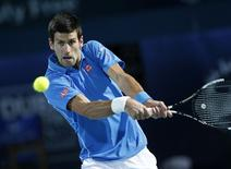 Novak Djokovic of Serbia returns the ball to Tomas Berdych of Czech Republic during their semi-final match at the ATP Championships tennis tournament in Dubai, February 27, 2015. REUTERS/Ahmed Jadallah