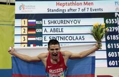 Ilya Shkurenyov of Russia celebrates winning the men's hepthatlon event during the European Indoor Championships in Prague March 8, 2015. REUTERS/David W Cerny