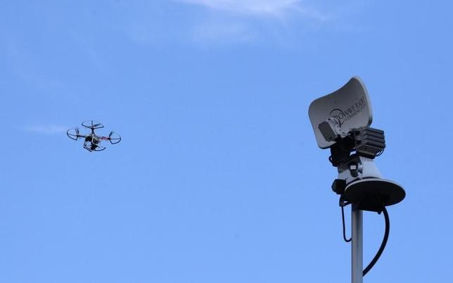 A drone is seen next to a television antenna in Pinecrest, Florida September 2, 2014. REUTERS/Andrew Innerarity