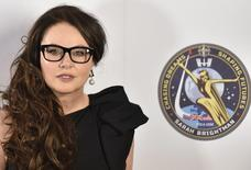British soprano Sarah Brightman poses for photographs after speaking about her travel to the International Space Station, at a news conference in central London March 10, 2015. REUTERS/Toby Melville