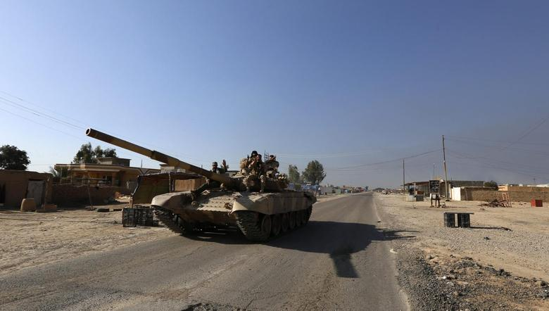 A tank of Iraqi security forces is seen in the town of al-Alam March 10, 2015. Iraqi troops and militias drove Islamic State insurgents out of al-Alam on Tuesday, clearing a final hurdle before a planned assault on Saddam Hussein's home city of Tikrit in their biggest offensive yet against the ultra-radical group. REUTERS/Thaier Al-Sudani