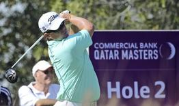 George Coetzee of South Africa watches his shot during the third round of the Qatar Masters at Doha Golf Club in Doha, January 23, 2015. REUTERS/Fadi Al-Assaad