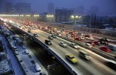 Cars drive along a bridge after snowfall in Urumqi, Xinjiang Autonomous region, November 28, 2014. Picture taken November 28, 2014. REUTERS/Stringer
