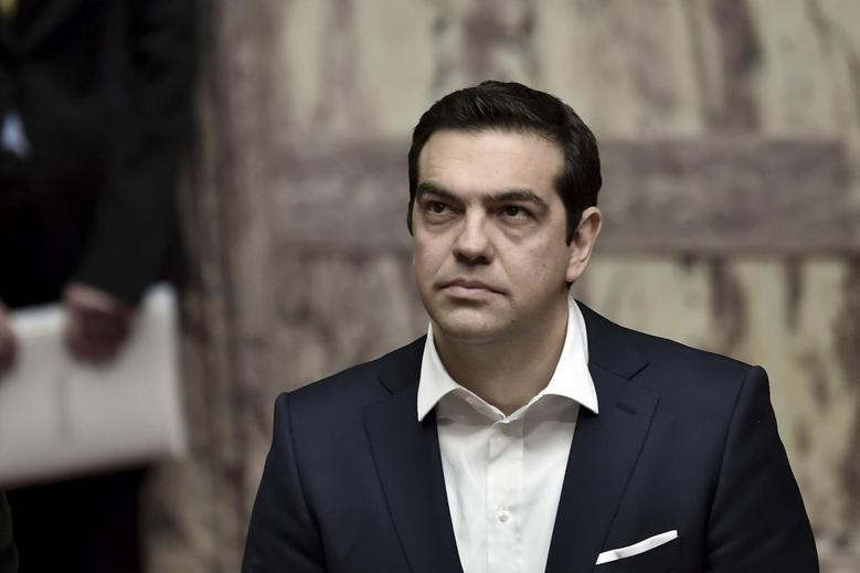 Greek Prime Minister Alexis Tsipras attends the swearing-in ceremony of newly elected President Prokopis Pavlopoulos (not pictured) at the parliament in Athens March 13, 2015.  REUTERS/Aris Messinis/Pool