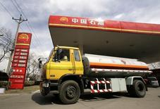A petrol delivery vehicle drives past a PetroChina gas station in Beijing, March 25, 2010. REUTERS/Jason Lee