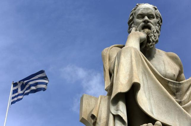 A Greek flag flutters by a statue of ancient Greek philosopher Socrates in central Athens March 18, 2015. REUTERS/Yannis Behrakis