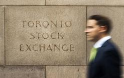 A man walks past an old Toronto Stock Exchange (TSX) sign in Toronto, June 23, 2014. Canada's main stock index was little changed on Monday as weakness in financial and energy shares offset gains in the materials sector.   REUTERS/Mark Blinch (CANADA - Tags: BUSINESS) - RTR3VBYO