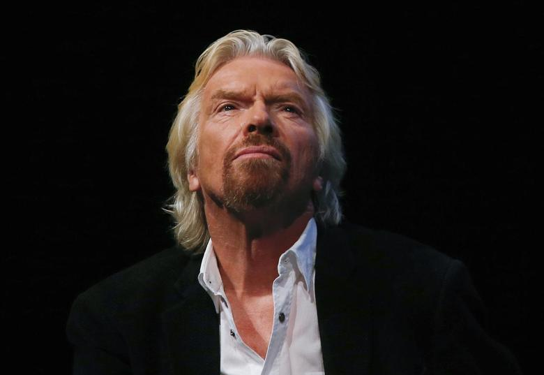 Sir Richard Branson listens to a speaker at the Global Commission on Drug Policy in New York, in this September 9, 2014 file photo. REUTERS/Shannon Stapleton