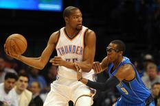 Feb 19, 2015; Oklahoma City, OK, USA; Oklahoma City Thunder forward Kevin Durant (35) handles the ball against Dallas Mavericks guard Rajon Rondo (9) during the first quarter at Chesapeake Energy Arena. Mandatory Credit: Mark D. Smith-USA TODAY Sports