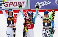 Mikaela Shiffrin of the U.S. (C) celebrates with Sweden's second placed Frida Hansdotter (L) and third placed Veronika Velez Zuzulova of Slovakia (R), after winning the World Cup slalom trophy at the Alpine Skiing World Cup Finals in Meribel, in the French Alps, March 21, 2015    REUTERS/Robert Pratta