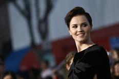 The writer of 'Insurgent' Veronica Roth poses for photographs in Los Angeles, California March 18, 2014.  REUTERS/Mario Anzuoni