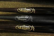 The new logo for the new Louisville Slugger bats is displayed on the top and bottom bats with the old logo in the middle at  Hillerich & Bradsby's Louisville Slugger plant, Kentucky, April 1, 2013.   REUTERS/ John Sommers II
