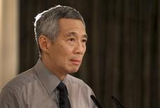 Singapore's Prime Minister Lee Hsien Loong addresses the nation after the passing of his father former prime minister Lee Kuan Yew at the Istana in Singapore March 23, 2015. REUTERS/Ministry of Communications and Information of Singapore/Terence Tan/Handout via Reuters