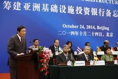 China's Finance Minister Lou Jiwei (L) gives a speech, with the guests of the signing ceremony of the Asian Infrastructure Investment Bank at the Great Hall of the People in Beijing October 24, 2014. REUTERS/Takaki Yajima/Pool