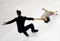 Meagan Duhamel and Eric Radford of Canada compete in the pairs short program during the ISU World Figure Skating Championship in Shanghai March 25, 2015. REUTERS/Carlos Barria