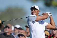 Tiger Woods hits his drive on the 12th during the first round of the Farmers Insurance Open golf tournament at Torrey Pines Municipal Golf Course - South Co. Mandatory Credit: Jake Roth-USA TODAY Sports