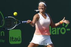 Victoria Azarenka hits a forehand against Silvia Soler-Espinosa (not pictured) on day two of the Miami Open at Crandon Park Tennis Center. Azarenka won 6-1, 6-3. Mandatory Credit: Geoff Burke-USA TODAY Sports