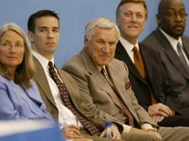 Former head basketball coach at the University of North Carolina at Chapel Hill Dean Smith (C) listens as Roy Williams answers questions from the media during a press conference held at the Dean E. Smith Center in Chapel Hill, North Carolina April 14, 2003  REUTERS/Ellen Ozier