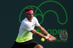 Juan Martin Del Potro hits a backhand against Vasek Pospisil (not pictured) on day three of the Miami Open at Crandon Park Tennis Center. Pospisil won 6-4, 7-6 (7). Mandatory Credit: Geoff Burke-USA TODAY Sports