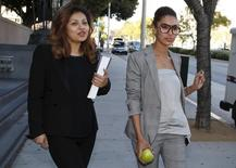 Companion of ex-NBA Clippers owner Donald Sterling, V. Stiviano (R), walks out of the courthouse in Los Angeles, California March 26, 2015. REUTERS/Lucy Nicholson